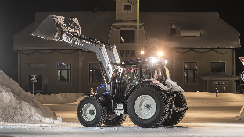 valtra unlimited customised tractor with track at the alps at snow work